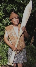 Ben, Sr. and paddle he carved in 1993